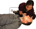 Student practicing adult CPR with another student