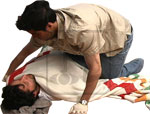 Image of victim in shock and a first responder checking for vital signs.
