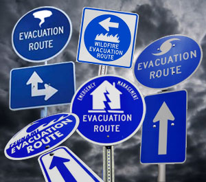 Image of signs reading: evacuation route, wildfire evacuation route, evacuation route, emergency management evacuation route, and tsunami evacuation route.